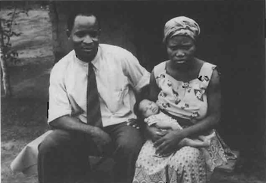 Reverend Udo-Ete with his wife and child