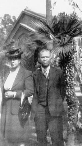 Abner Howell and his wife, Martha, in front of a palm tree