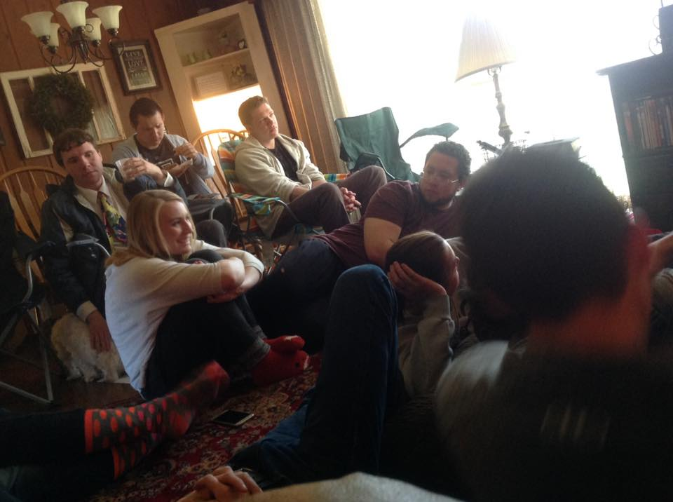 C. Randall Nicholson and several members of the Logan YSA 35th Ward of the Church of Jesus Christ of Latter-day Saints watching General Conference in Bishop Doug Corbridge's home