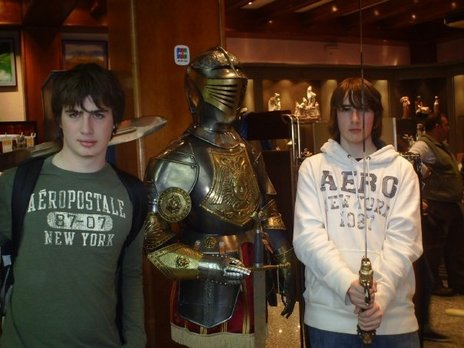 Daniel Frohm and Derek LaBaff with a suit of armor in some Toledo gift shop.