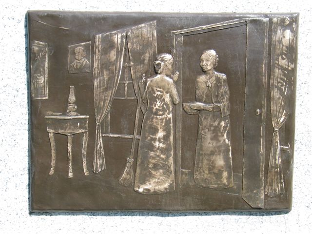 Metal monument engraving of Jane Manning James giving half her flour to Eliza Partridge Lyman