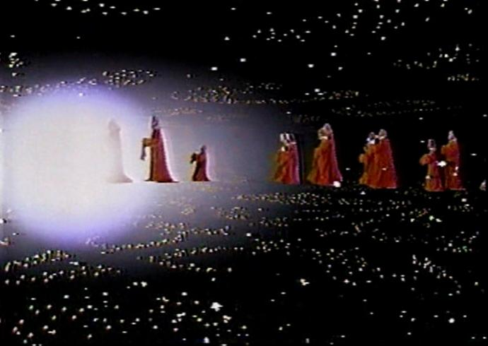 The Star Wars Holiday Special: Wookiees in red robes walking through space into a star